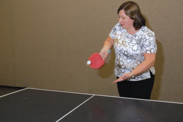 Yelena Raykhel, an electronics mechanic at Tobyhanna Army Depot, serves during a friendly ping pong match over her lunch break.