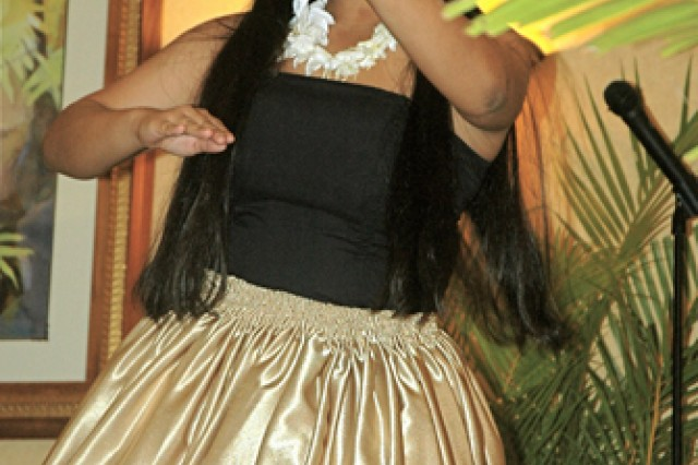 "Dancer Nicole Kamada dances the hula to the mele, or song, ""Kukaniloko,"" during a recent Native Hawaiian Lecture Series event at the Nehelani, Schofield Barracks."
