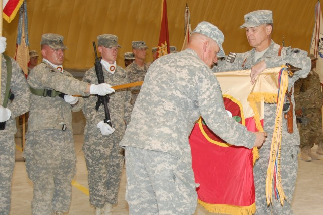 Brig. Gen. Philip R. Fisher, commander of the 184th ESC and Command Sgt. Maj. Jeffrey L. Riggs case the color of the 184th Expeditionary Sustainment Command during a transfer of authority ceremony hosted by the 4-401st Army Field Support Brigade at Kandahar Airfield.