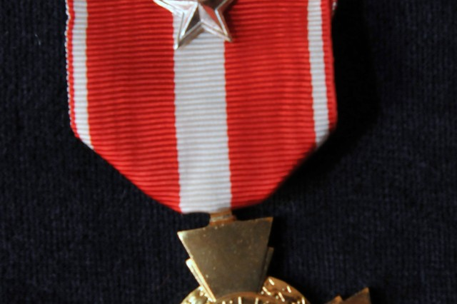 The French Croix de la Valeur Militaire, roughly equivalent to the Silver Star, was awarded to one active duty and five National Guard Special Forces Soldiers in a private ceremony at the French ambassador's residence in Washington, D.C., July 25, 2011.