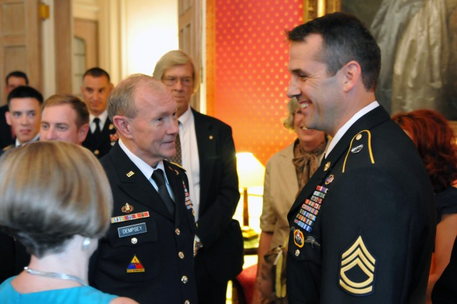 Gen. Martin Dempsey, chief of staff of the Army and nominee for chairman of the Joint Chiefs of Staff, and his wife Deanie, talk with Army National Guard Sgt. 1st Class Ryan Ahern of the 20th Special Forces Group (Airborne) at the French Ambassador's Residence in Washington, D.C., July 25, 2011, before a private ceremony awarding the French Croix de la Valeur Militaire, roughly equivalent to the Silver Star, to one active duty and five National Guard Special Forces Soldiers. Ahern was one of the award recipients.