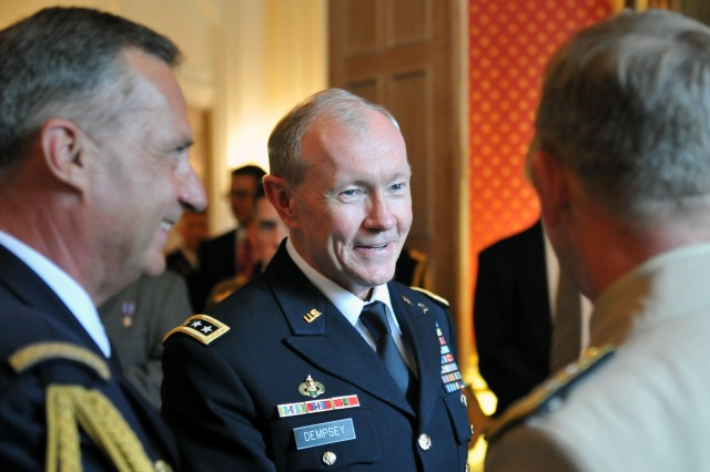 Gen. Martin Dempsey, chief of staff of the Army and nominee for chairman of the Joint Chiefs of Staff, talks with guests at the French ambassador's residence in Washington, D.C., July 25, 2011, before a private ceremony awarding the French Croix de la Valeur Militaire, roughly equivalent to the Silver Star, to one active duty and five National Guard Special Forces Soldiers.