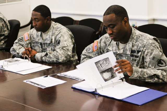 Sgt. 1st Class Lafonte Bennett (right) reviews nominations for the Army's Greatest Inventions award program July 21, 2011 at Aberdeen Proving Ground, Md.