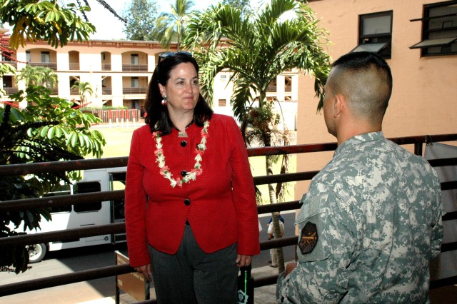 """CSM Giles Almeida discusses the """"B"""" Quad Barracks with Ms. Hammack during her tour of the installation. The barracks are more than 100 years old and still housing Soldiers. (US Army Photo)"""