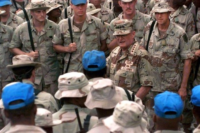 Gen. John M. Shalikashvili, then-chairman of the Joint Chiefs of Staff, is surrounded by Soldiers operating on Sword Base, Mogadishu, Somalia, Dec. 19, 1993, during his tour of United Nations Operations in Somalia II operations