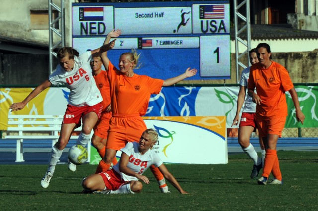 Military Team USA soccer players Air Force 2nd Lt. Rachel Emory (left) and Air Force Capt. Brittney Perkowski battle Netherlands for possession of the ball during Team USA's 1-0 victory July 20 at the 5th CISM Military World Games in Rio de Janeiro, Brazil. (U.S. Army photo)