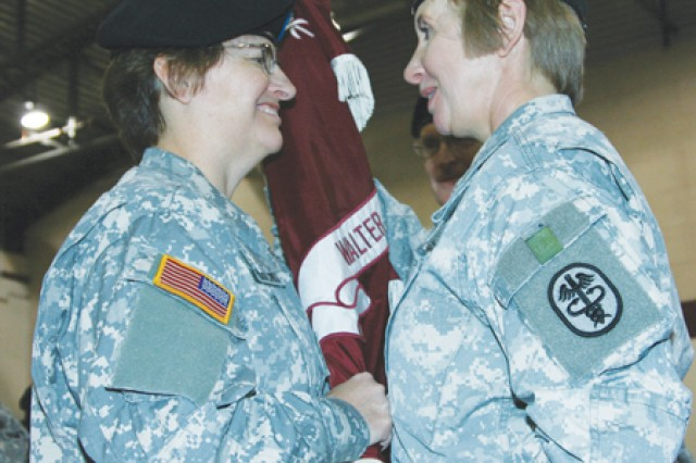 Maj. Gen. Carla Hawley-Bowland (left) is given the colors and command of the North Atlantic Regional Medical Command (now Northern Regional Medical Command) and Walter Reed Army Medical Center by Maj. Gen. Gale Pollock, acting U.S. Army surgeon general, Dec. 11, 2007, at Walter Reed Army Medical Center.