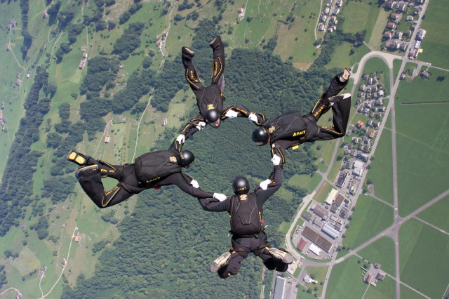 A four-person formation of U.S. Army Golden Knights parachutists jumps over Bouchs, Switzerland, at 2010 World Military Parachuting Championship, July 16, 2010.