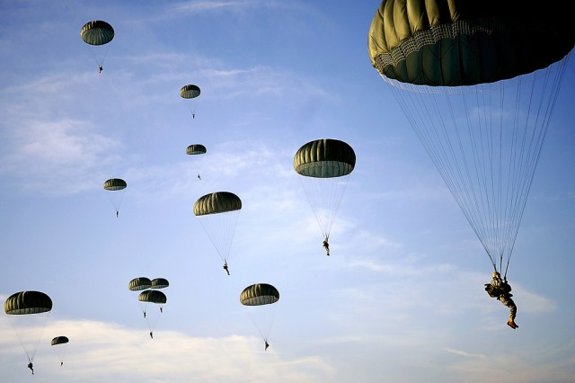 Soldiers from the 82nd Airborne Division, Fort Bragg, NC., descend from an aircraft during Operation Toy Drop on Fort Bragg, N.C., Dec. 6, 2008.
