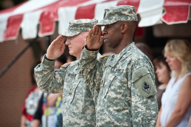 Brig. Gen. Bryan Watson, U.S. Army Engineer School commandant, and Command Sgt. Maj. Terrence Murphy, USAES regimental command sergeant major, render a military salute during the Review and Departure Ceremony held for Watson on July 14 at Fort Leonard Wood. Watson, who has served at Fort Leonard Wood since March 2009, will be taking on the responsibilities of director, J-7, engineering, U.S. Forces-Afghanistan. Army Photo/Michael Curtis