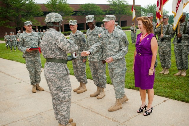Brig. Gen. Bryan Watson was presented a cannon shell in remembrance of the cannon salute that was rendered during a Review and Departure Ceremony held for Watson on July 14, on the Maneuver Support Center of Excellence Plaza, Fort Leonard Wood, Mo. Army Photo/Michael Curtis