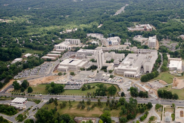 The new Walter Reed National Military Medical Center, seen from the air, with Wisconsin Avenue in front still shows the original tower that Franklin Delano Roosevelt designed. But the growth around that tower has expanded to include portions of the old Walter Reed Army Medical Center.
