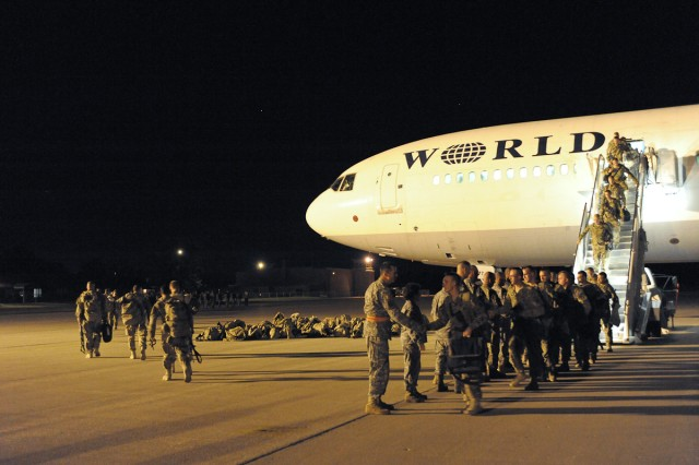 Soldiers of the Iowa Army National Guard's 2nd Brigade Combat Team, 34th Infantry Division, arrive at Volk Field, Wis., July 12, 2011, after their one-year deployment in Afghanistan. The Soldiers then traveled about 25 miles to Fort McCoy, Wis., where they went through a demobilization process led by First Army Division West.