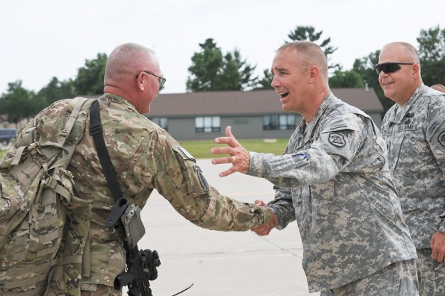 The Adjutant General of Iowa Maj. Gen. Timothy Orr, second from right, and Command Sgt. Maj. John Breitsprecker, right, Iowa Army National Guard command sergeant major, welcome back Soldiers of the Iowa Army National Guard's 2nd Brigade Combat Team, 34th Infantry Division, at Volk Field, Wis., July 10, 2011. The Soldiers were returning from a one-year deployment in Afghanistan.