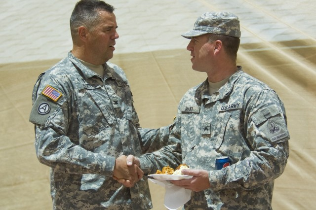 FORT BLISS, Texas (July 21, 2011) Chaplain (Col.) Peter Baktis, left, Fort Bliss' senior chaplain, greets Cpl. Todd Maki, at the 236th anniversary of the Army Chaplain Corps celebration on West Fort Bliss, July 21.