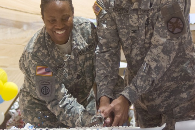 FORT BLISS, Texas (July 21, 2011) Chaplain (Col.) Peter Baktis, Fort Bliss' senior chaplain, and Sgt. 1st Class Sharlene Lynch, cut a celebratory cake on West Fort Bliss, July 21.