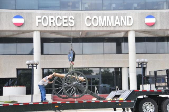 FORT McPHERSON, Ga. (July 25, 2011) – One of two 12-pound Napoleon cannons at the front of the old Army Forces Command headquarters here is loaded up for shipment to FORSCOM's new home at Fort Bragg, N.C.