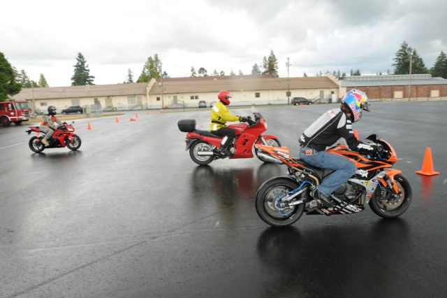 Aaron Colton, professional sport bike rider conducts slow riding training with Soldiers and civilians who came to the clinic held at Joint Base Lewis-McChord July 13. Colton came out to show off his skills on a sport bike, but also to talk with other riders about safety, motorcycle choices and how to properly handle their motorcycle.