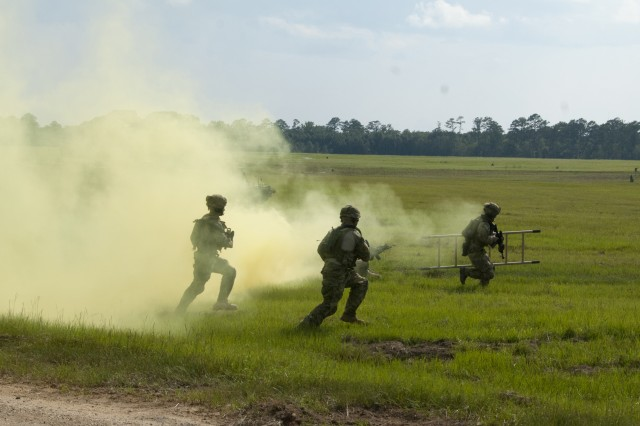 U.S. Army Rangers from 75th Ranger Regiment run through concealing smoke, July 25, as they maneuver their way towards a mock insurgent building as part of an assault on the structure on Fryar Drop Zone, Fort Benning, Ga.., as part of the Regiment's 2011 Ranger Rendezvous events.
