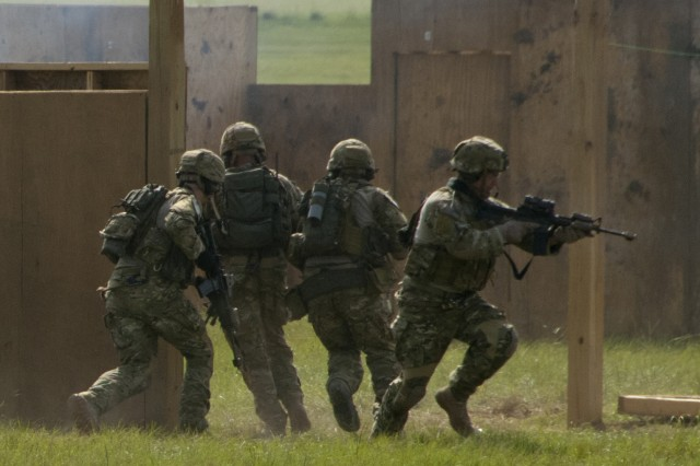 U.S. Army Rangers from the 75th Ranger Regiment breach and enter the walls of a mock insurgent building, July 25, as part of an assault on the structure on Fryar Drop Zone, Fort Benning, Ga., as part of the Regiment's 2011 Ranger Rendezvous events.