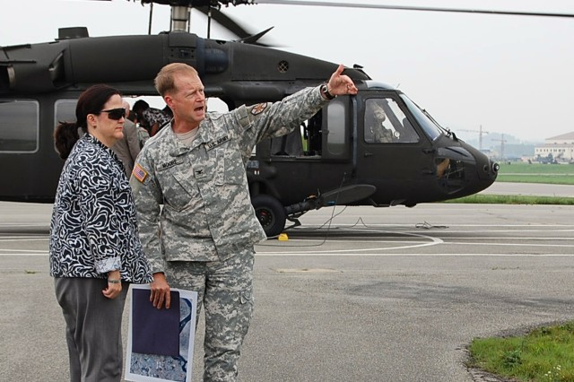 Just before going on an aerial tour of Camp Humphreys, South Korea, Col. Joseph P. Moore, garrison commander, explains to Katherine Hammack, assistant secretary of the Army for Installations, Energy and Environment, the route they are going to fly, during her visit here July 26, 2011.