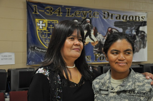 Calypso Noger, left, congratulates her daughter Pvt. Genievev Sims, Company D, 1st Battalion, 34th Infantry Regiment, during her daughter's naturalization ceremony Wednesday. Sims is a member of the Leyte Dragons battalion and hails from Leyte, Philippines.