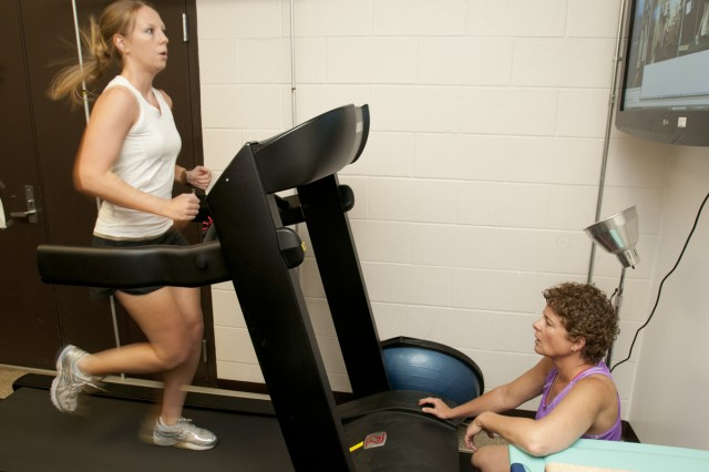Christina Kurty(right), licensed trainer, helps Senior Airman Taylor Prichard 194th Squadron targeteer, during her visit to the Gait Analysis Program at Wilson Sports and Fitness Center, Joint Base Lewis-McChord.  Kurty takes servicemembers through various exercises and workouts to help many who are recovering from injuries or who are looking to increase their running performance.