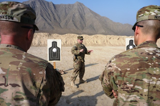 Sgt. 1st Class Vincent Branchetti, the range noncommissioned office-in-charge, gives instruction at Kabul Military Training Center's Range 17 during an introduction to Quick Reaction Drill Training July 28. (Photo by Jon Connor)