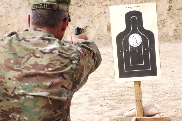 Brig. Gen. Tom Cosentino, deputy commander-Regional Support, fires at a 25-meter target during Quick Reaction Drill Training at Kabul Military Training Center's Range 17 July 28. (Photo by Jon Connor)