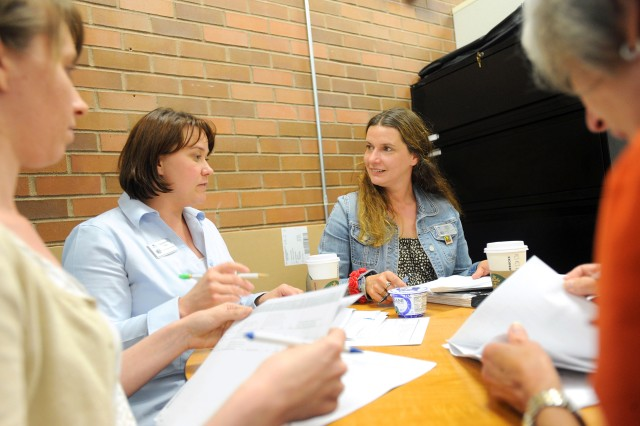 Jaclyn Gilley, left, Jackie Kelly, Sybille White and Mary Herrera meet frequently at the EFMP office to help identify and solve problems facing EFMP families on JBLM.
