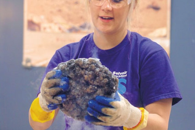 Science teacher Brandy Stewart holds up a comet she created with dry ice for students taking part in Science Camp July 21.