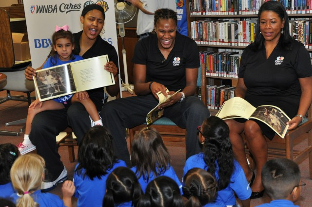 Kids enjoy listening to Maya Moore, Rebekka Brunson and Laurel Ritchie read July 22 at the Keith A. Campbell Library on Fort Sam Houston.