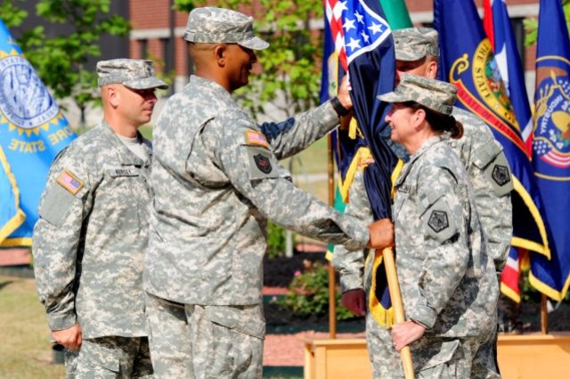 Col. Jason T. Evans, the 65th Adjutant General of the U.S. Army (TAG), accepts the Adjutant General Corps colors from Maj. Gen. Gina S. Farrisee, commanding general of U.S. Army Human Resources Command, during a July 28 ceremony at Fort Knox, Ky. This ceremony confers three roles on Evans. In addition to being TAG, Evans serves as the 16th executive director of the Military Postal Service Agency and the 18th commanding general of the Army Physical Disability Agency.