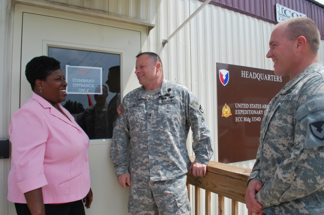 (Left to right) Glenda Malden, Expeditionary Contracting Command supervisory human resources specialist Brig. Gen. Joe Bass, ECC commanding general and  Col. Tim Strange, ECC chief of staff, discuss day-today business and their new surrounding at their new offices on Redstone Arsenal, Ala.
