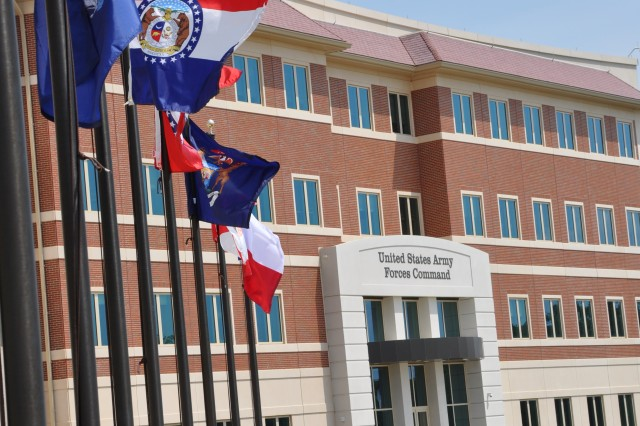 FORT BRAGG, N.C. (July 28, 2011) - The raising of the state and U.S. territory flags and the placement of two Napoleon 12-pound cannons this week have added finishing touches to the front of the new FORSCOM/USARC combined headquarters complex here.