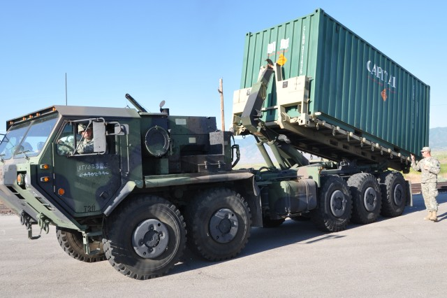 Military Palletized Load System (PLS) loads container ready to transport to Hawthorne, Nev.