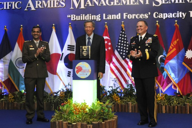 (Left to right) Maj Gen. Ravinder Singh, Chief of Army, Singapore Armed Forces, Dr. Ng Eng Hen, Singapore Minister of Defense and Lt. Gen. Francis Wiercinski, commander of U.S. Army Pacific , officially open the Pacific Armies Chiefs Conference in Singapore 28 Jul.