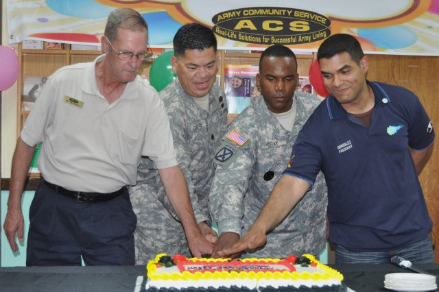 Bill Spearman, Suwon ACS manager; Lt. Col. William Darne, commander of 6-52nd ADA Battalion, Command Sgt. Maj. Spencer Gray, Humphreys Garrison command sergeant major, and Spc. Kevin Gonzalez, Suwon Air Base BOSS president, cut the cake during the 46th anniversary ACS celebration.