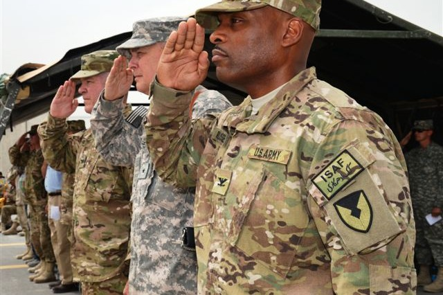 Col. Michel M. Russell, Sr., 401st Army Field Support Brigade commander accepts the brigade colors from Brig. Gen. Philip R. Fisher, Joint Sustainment Command-Afghanistan commander, during a change of command ceremony held at brigade headquarters July 17.
