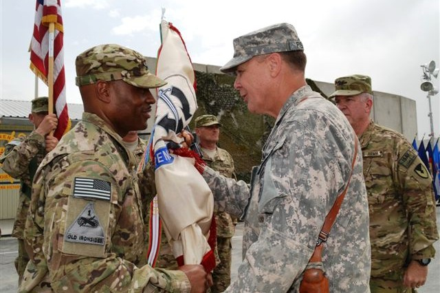 (from left) Col. Richard B. O'Connor, II, outgoing 401st Army Field Support Brigade Commander, Brig. Gen. Philip R. Fisher, Joint Sustainment Command – Afghanistan commander, and Col. Michel M. Russell, Sr. incoming 401st AFSB commander salute during a change of command ceremony held at brigade headquarters July 17 in which Russell assumed command of the brigade from O'Connor.