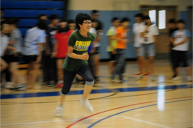 """Kim Sang-ryul, a student at Waegwan Middle School, sprints during a relay race during group activity time as part of an """"English camp"""" at USAG Carroll's Crown Jewel Gym July 27, 2011. The 7th Annual USAG Carroll English Camp  ran from July 25-29, 2011.  The five-day camp is part of U.S. Forces Korea's Good Neighbor Program and  is provided for students at Waegwan Middle School.  It is designed to enhance cultural awareness and provide Korean students an opportunity to use, improve, and develop confidence in the English language skills through interaction with native English speakers. Photo by Pfc. Sung Kwang-jae"""