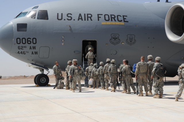 Members of the 183rd Maintenance Company board the  C-17 to redeploy. (Photo By Joan Kibler)