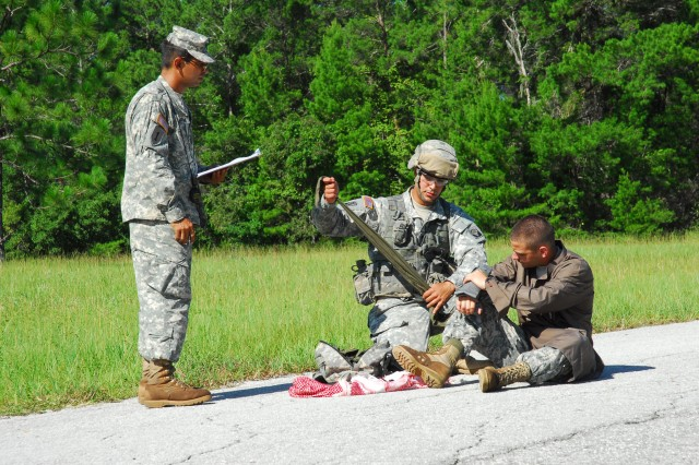 A Soldier from the 53rd Infantry Brigade Combat Team applies a splint to a simulated fracture during Expert Infantryman Badge testing at Camp Blanding Joint Training Center, July 19, 2011. The Florida National Guard's 53rd IBCT is conducting EIB testing for the first time in more than 20 years. Photo by Sgt. 1st Class Blair Heusdens