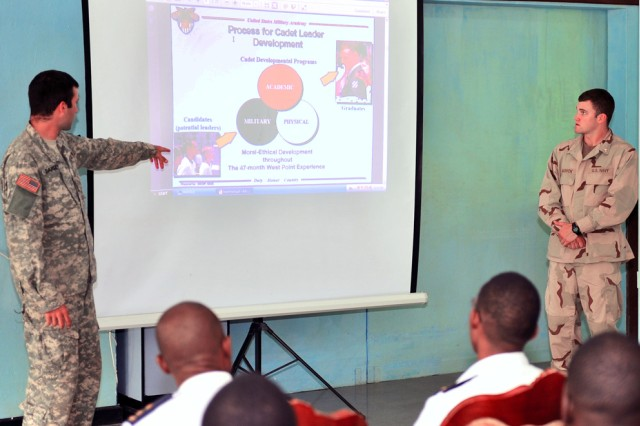 U.S. Military Academy Cadet 1st Class Jake Darsey (left) and U.S. Naval Academy Midshipmen 1st Class Patrick Bagnick, teach a class on leadership development to a group of Tanzanian People's Defense Force Navy second lieutenants June 16, in Dar Es Salaam, Tanzania.