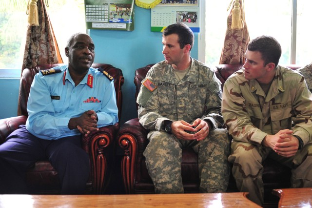 Tanzanian People's Defense Force Maj. Gen. S.S. Omar (left), Chief of the TPDF Navy, sits with U.S. Military Academy Cadet 1st Class Jake Darsey and U.S. Naval Academy Midshipmen 1st Class Patrick Bagnick to discuss the role of junior officers in shaping the future of their militaries in Dar es Salaam, Tanzania, June 17.