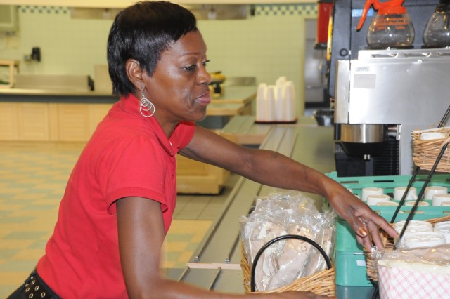 Trina Rivers, a food service attendant for 12 years at the Fort McNair DFAC, makes final preparations for the special farewell meal served honoring the closing of the 106 year old facility July 29, 2011.