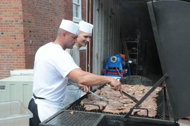 PFC Alex Ortega (left) and PFC Justin Higginbotham grill steaks in preparation for the special farewell meal served at the Fort McNair DFAC, honoring the closing of the 106 year old facility July 29, 2011.