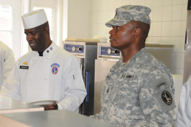 Sgt. First Class Billy Yarborough and Joint Force Headquarters - National Capital Region and the U. S. Army Military District of Washington Command Sgt. Maj. Michael W. Williams serve customers during the special farewell meal served at the Fort McNair DFAC, honoring the closing of the 106 year old facility July 29, 2011.