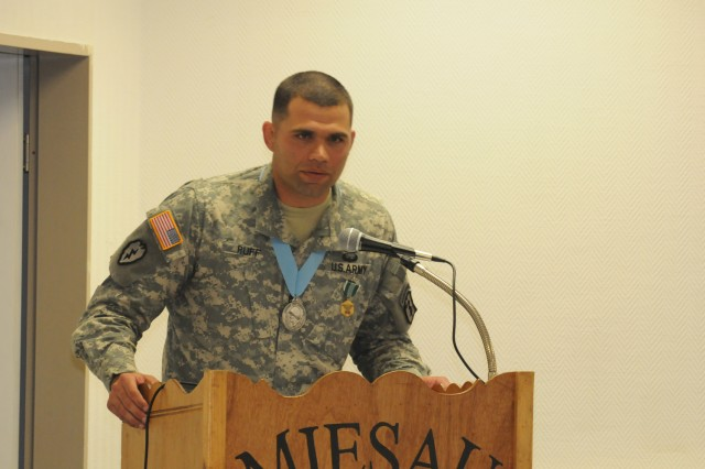 Sgt. 1st Class Andrew Ruff, 67th Forward Surgical Team (Airborne) detachment sergeant, speaks to the audience after being inducted into the Sergeant Audie Murphy Club July 28 in Miesau, Germany.