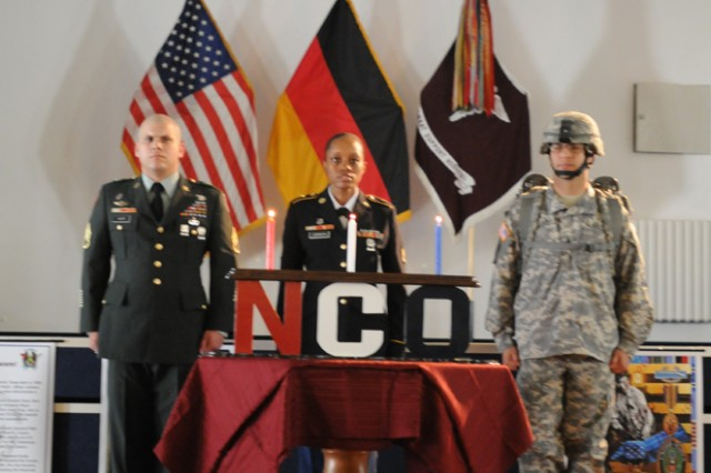 Noncommissioned Officers from the 212th Combat Support Hospital stand at attention after reciting the NCO Creed during the Sergeant Audie Murphy Club Induction Ceremony July 28 in Miesau, Germany.